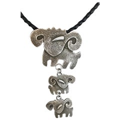 Rams, cast sterling silver pendant Melanie Yazzie new Navajo necklace aries