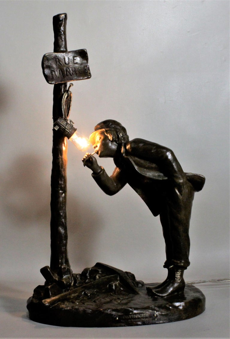 This antique patinated bronze cast spelter table lamp was designed by A. Renieri and made in France in circa 1890 in the Victorian style. The casting is quite detailed and is entitled