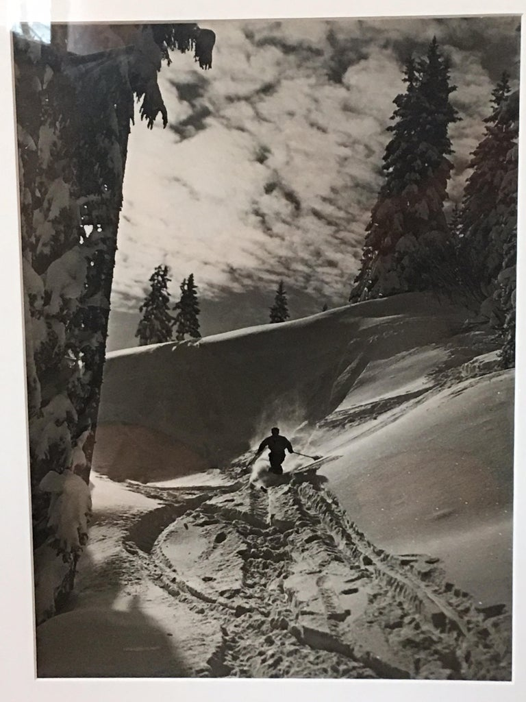 Raoul Doucet downhill skiing black and white photograph from the late 1950s-early 1960s. Silver print in great condition with no discoloration or stains. Known for his skiing photos full of action! Overall framed measurements 17.5 x 22