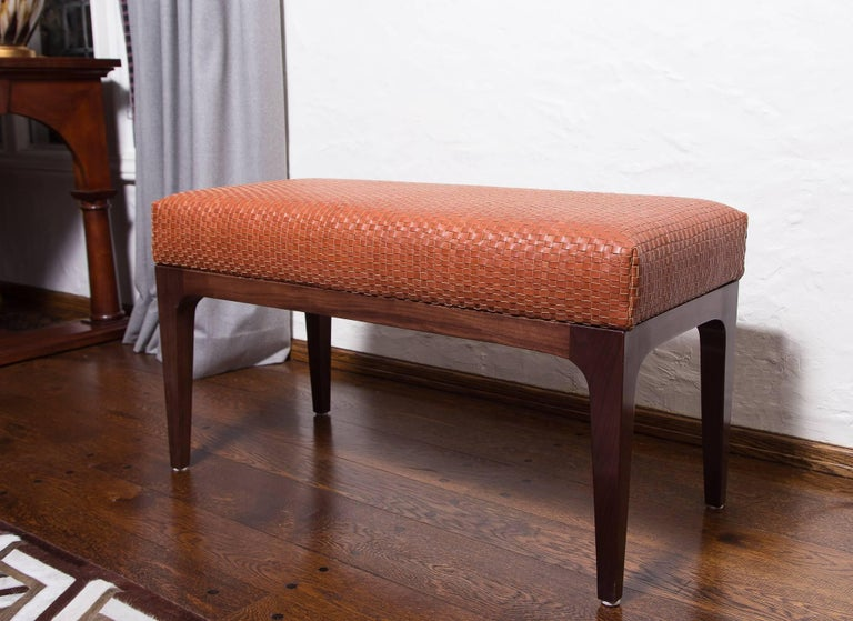 Mid-Century Modern style woven leather 3 ft bench.  Handwoven Italian leather seat Mid-Century Modern style frame Natural finish Walnut wood Measures: 36