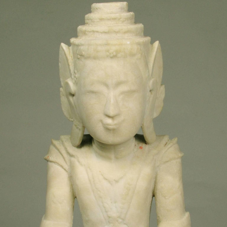 17th century Burmese Shan carved marble Buddha dressed in royal robes in the gesture of