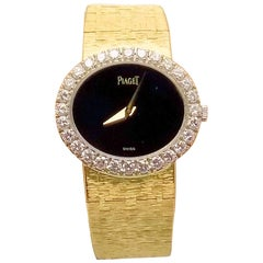 Rare 18 Karat Yellow Gold Lady's Stone Dial and Diamond Bezel Piaget Wrist Watch
