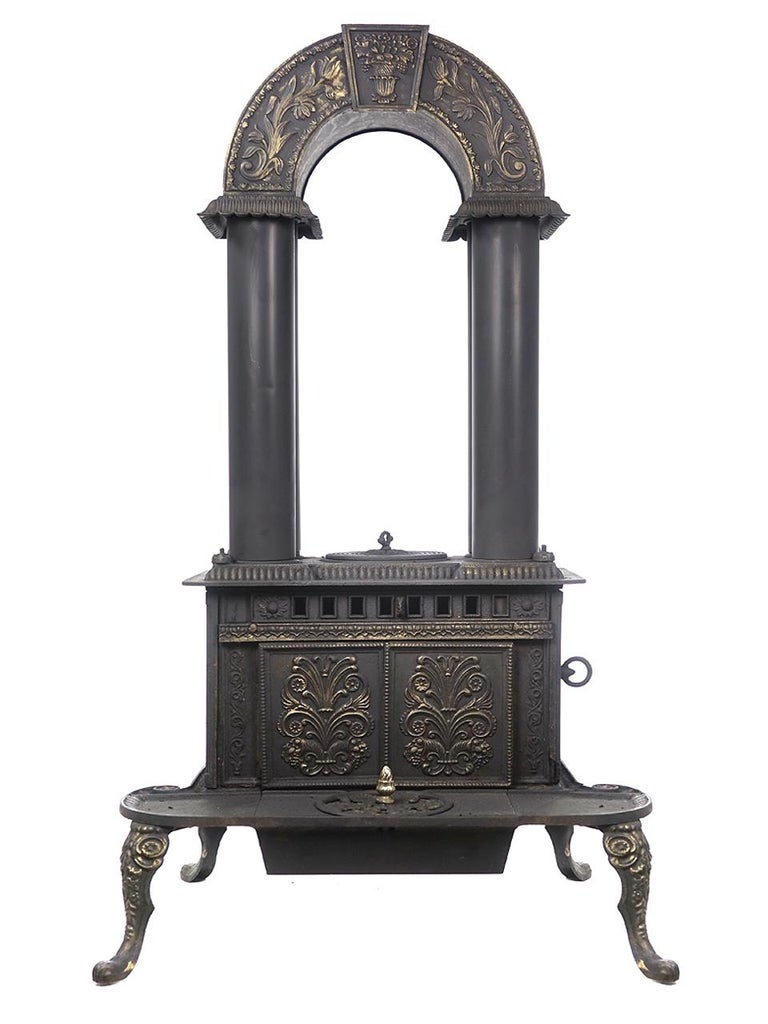This is a stove that you will never see and the look is amazing. Its signed G.E.Waring - No.1. It was made in New York in 1840. It cast iron with four copper vertical tubes.