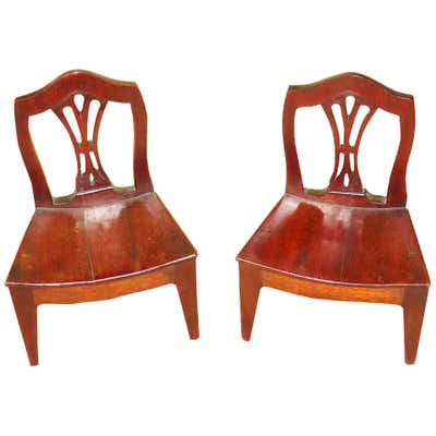 A rich mahogany finish pairs with an open design to round