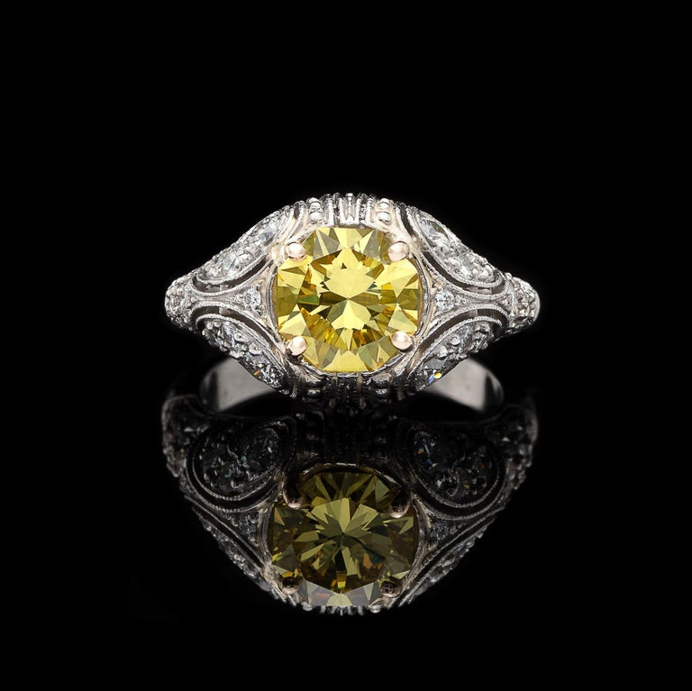 A distinctly one-of-a-kind ring. Set with an extraordinary 1.69-cts. octagonal modified brilliant-cut Fancy Intense Yellow diamond, SI1 clarity, on a handcrafted French-made openwork mounting be celebrated designer Sebastien Barier, which is set