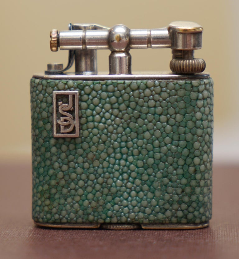We are delighted to offer for sale this stunning antique Dunhill Shagreen lighter  A very rare good looking and functional piece of collectible smoking equipment. Shagreen is exceptionally collectible on its own, it is Sharkskin and very