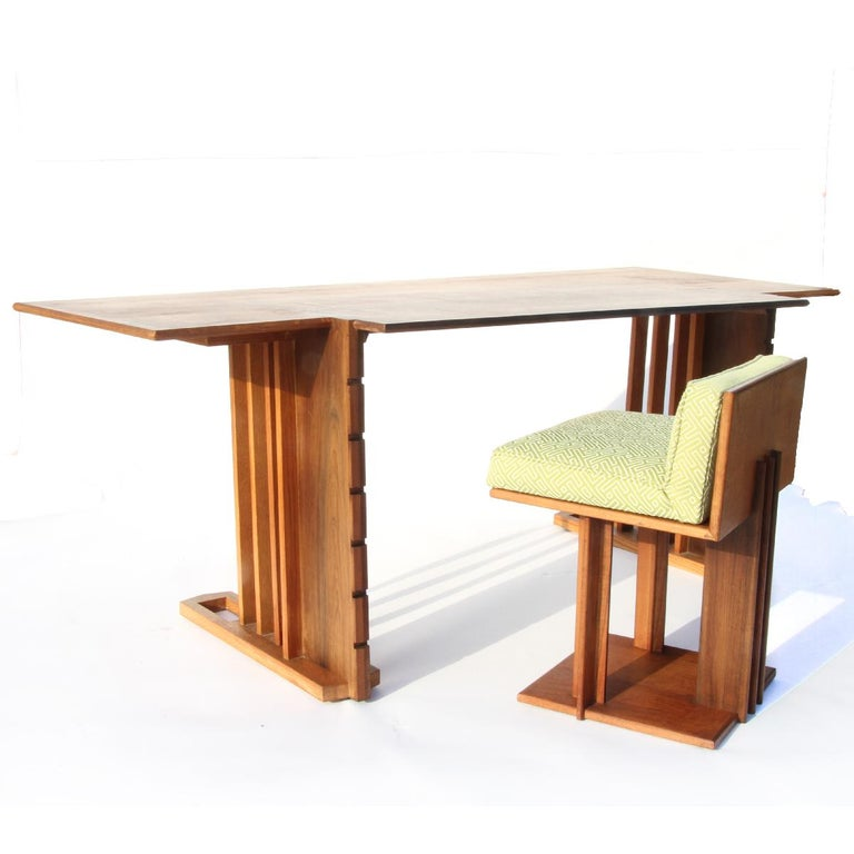 Very rare Unison desk and chair by Frank Lloyd Wright designed for the second owners of The Derby House in 1947. Desk is comprised of various woods, cherry, oak and walnut.