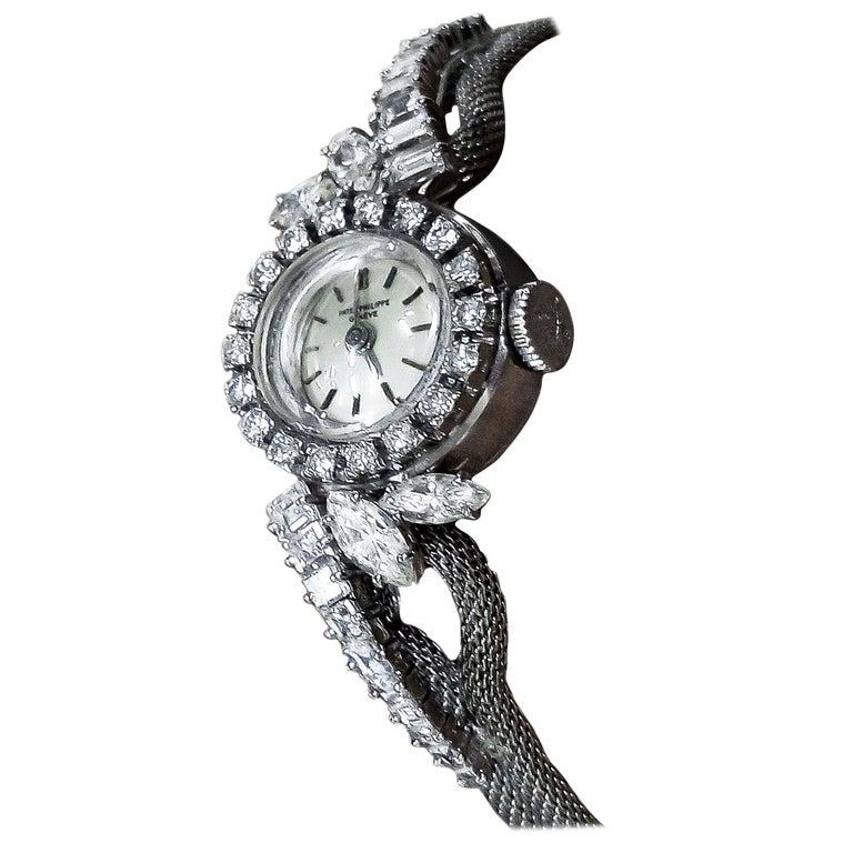 Rare 1950s-1960s Patek Philippe Platinum Triple Diamond Twist Motif Bracelet For Sale