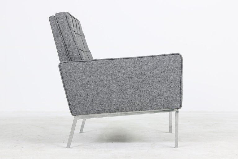 Beautiful,large and restored 1950s Florence Knoll Mod. 65a armchair, reupholstered and covered with new grey woven fabric, very good condition. Made by Knoll International.