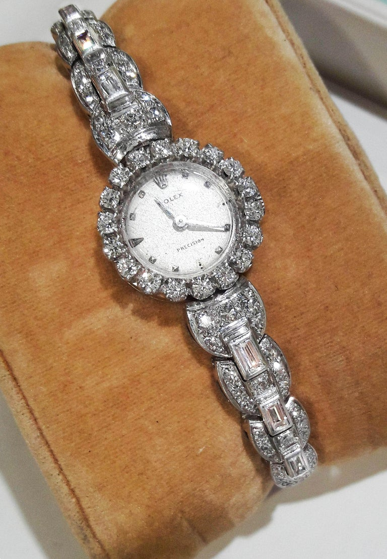 Dimensions 18mm X 18mm case size *Fits up to 170mm wrist  * Can be resized as complimentary service if  needed *Fully signed Dial , Case, Movement & Clasp   The present watch is a sophisticated rare, fully signed 1950s 18kt White Gold Rolex baguette