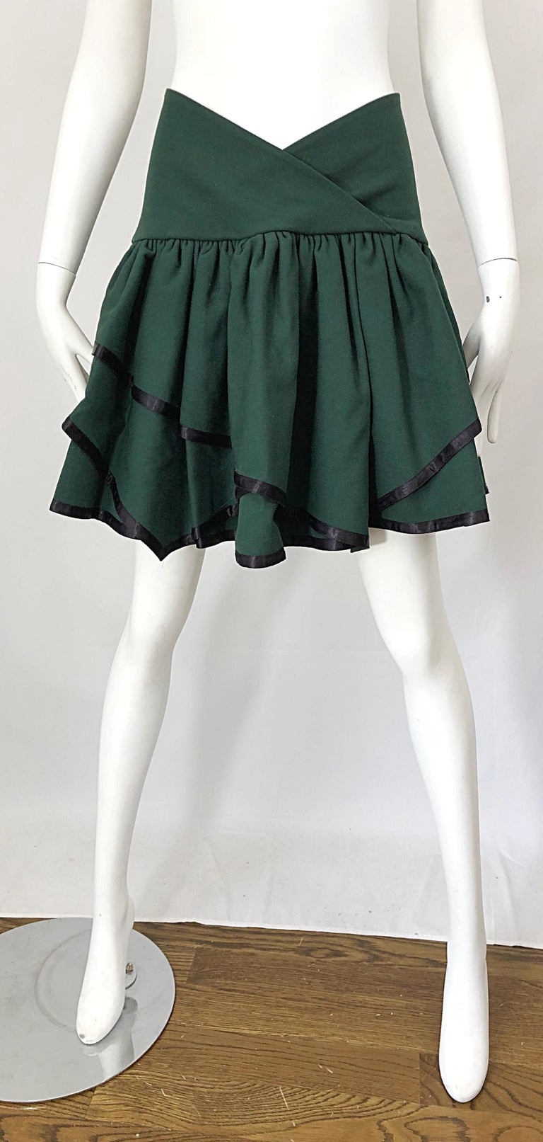 Rare late 1960s CARDINALI hunter / forest green lightweight wool handkerchief hem mini skirt! This beauty comes straight from Marilyn Lewis' estate (the designer and founder of Cardinali). The perfect green hue with black silk trimming each hem.