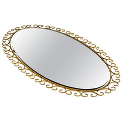 Rare 1960s Large Oval Sunburst Wall Mirror Made of Metal in Brass Anodized