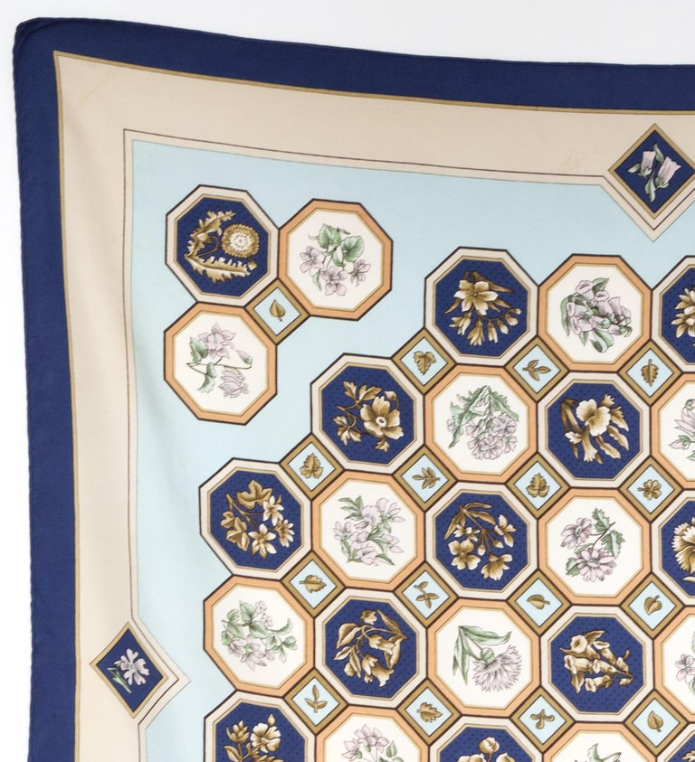 Rare Hermes silk scarf Carrelages by Maurice Tranchant featuring a navy border, a top logo signature.  In good vintage condition. Made in France. Only one issue: 1968 35,4in. (90cm)  X 35,4in. (90cm) We guarantee you will receive this  iconic item