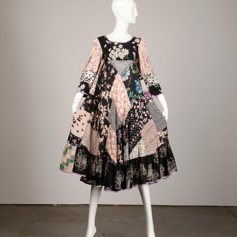 Rare San Francisco designer Helga Howie vintage 1970s patchwork dress with en empire waist, bell sleeves and incredible 1930s-inspired printed fabric. Unlined with no closure (pulls on over the head. The fabric content is not marked but it feels