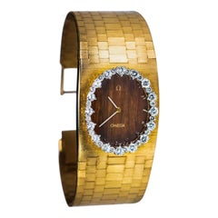 Rare 1970s Omega Diamond Set Wood Dial 18 Karat Yellow Gold Wristwatch