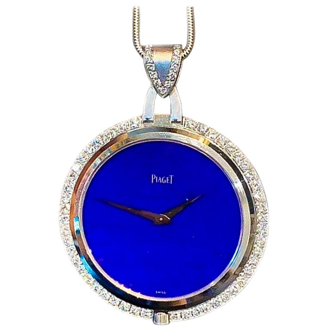 1970s Piaget 18 Karat White Gold Diamond Lapis Necklace and Pendant Watch