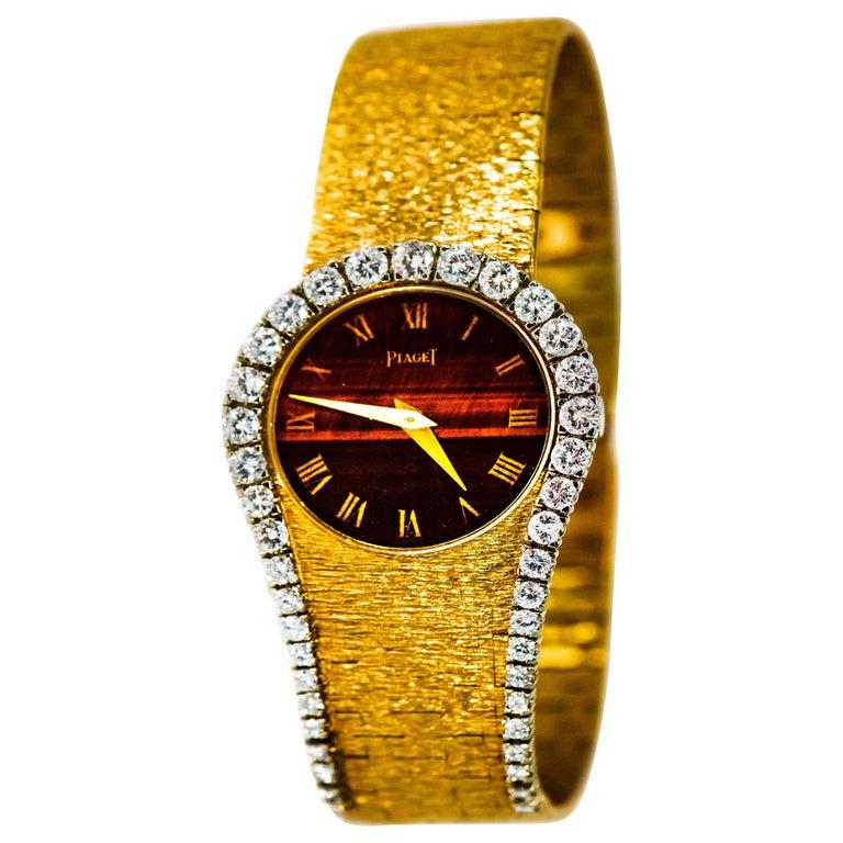 "Rare 1970s Piaget Tiger Eye Diamond Set ""Limelight"" Yellow Gold Bracelet Watch For Sale"