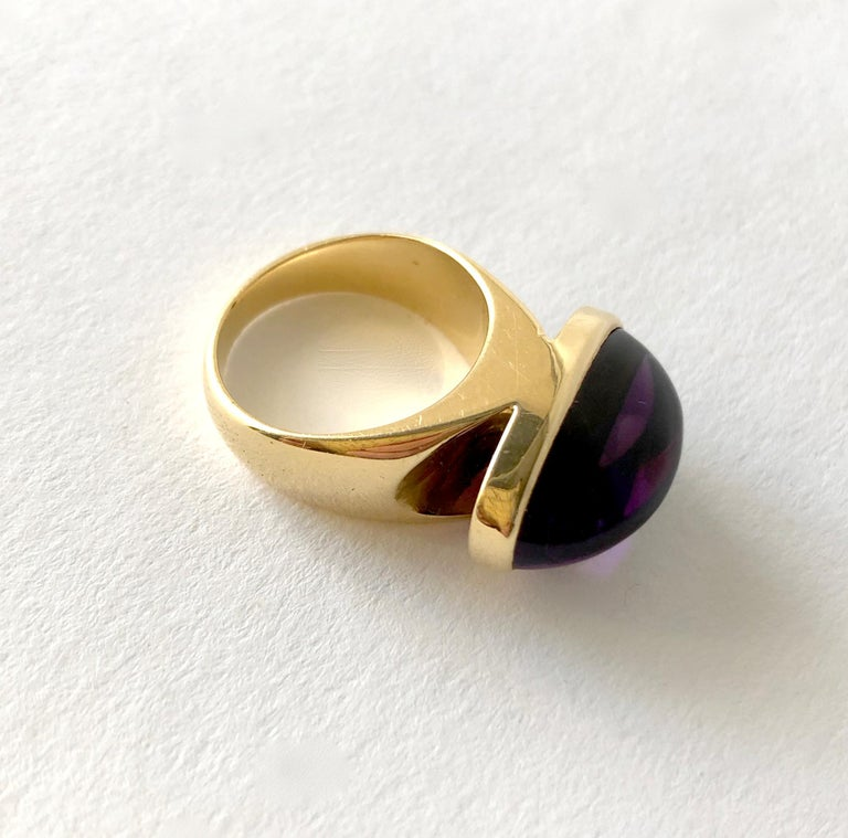 Rare, 18 karat gold ring with oval amethyst cabochon created by goldsmith Tuk Fischer for Georg Jensen, circa 1970's.  Ring is a finger size 6 to 6.25.  Signed Georg Jensen, 1096, Denmark, 18K, 750.  In very good vintage condition. 12.2 grams.