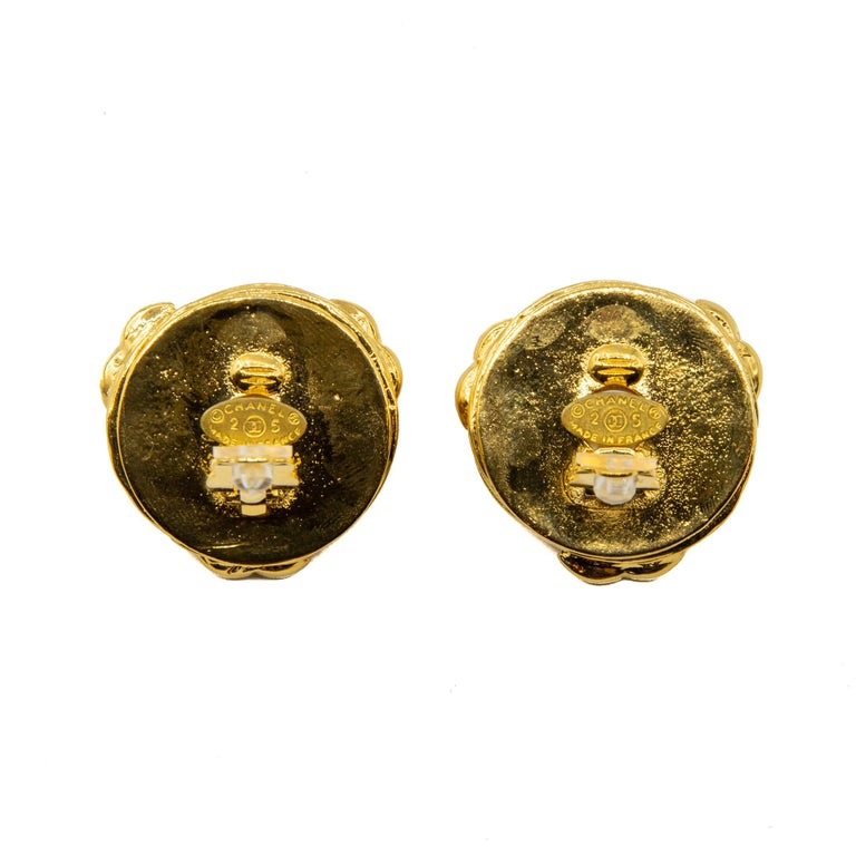 Rare 1980s collection 25 Chanel heavyweight baroque-inspired faux pearl and gilt clip-on earrings, featuring a swirl design with three large complementing house logos. This item carries the Chanel authenticity plaque. Provenience France.