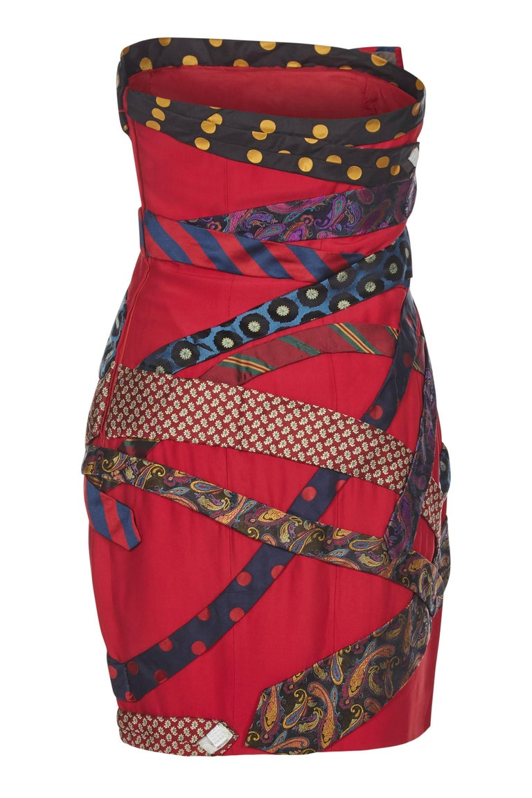 This extraordinary 1990s Moschino cocktail dress epitomises the dynamism and flare of the designer at his zenith. This piece of top label couture is magnificently adorned with pure silk men's ties which accompanied with the deep scarlet overtones,