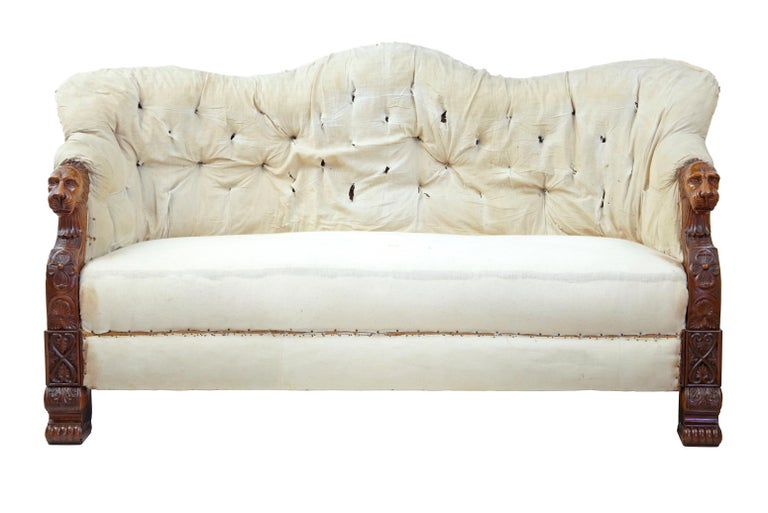 Superb quality north German walnut and mahogany sofa, circa 1840.  We are pleased to amazing quality sofa, which offers the potential for the customer to cover in their own fabric. High level of carving to the lion head, arms and gothic