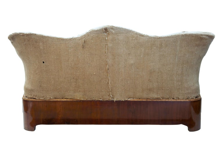 German Rare 19th Century Carved Walnut and Mahogany Button Back Sofa For Sale