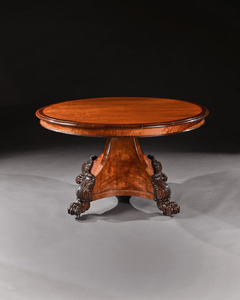 A rare and finely constructed circular satinwood centre table most probably by Henry Thomas Peters of Genoa.  Italy Circa 1830.  The circular tilt top having a finely chosen cuts of book-matched West Indian satinwood veneer with a rosewood