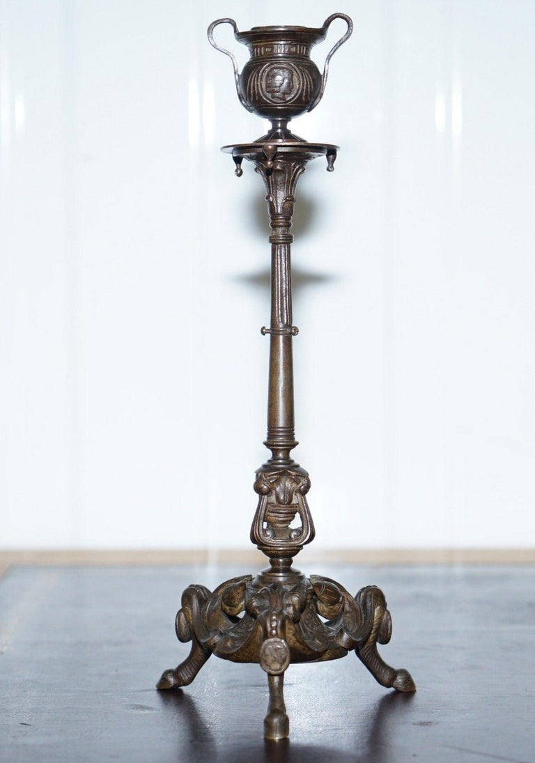 Wimbledon Furniture  We are delighted to offer for sale this simply stunning pair of solid bronze candlesticks after Auguste-Maximilien Delafontaine   The pair of candelabrum stand on triform legs with paw feet, and floral and foliage decoration at