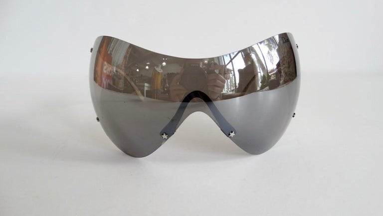 Snag yourself a piece from the Galliano for Dior vintage archives with these amazing sunglasses! Circa early 2000s, these ski sport sunglasses feature reflective large grey lenses and thick cherry red arms that include Dior in contrasting white