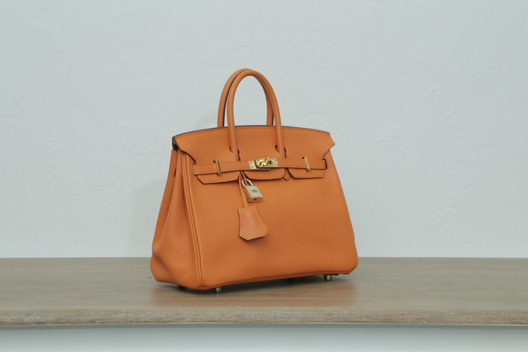 2006s Hermes Birkin 25 Orange with Gold Hardware.  J in a square. The bag come with the original duster and box.