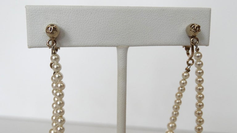 Who Doesn't Want To Be Dripping In Pearls? Especially Chanel! These adorable Chanel Pearl drop hoop earrings are from their 2014 Fall collection. Featuring a rounded circular strand of pearls which increase in size throughout the hooped strand. The