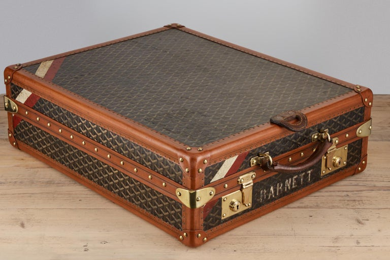Rare 20th century vintage Goyard trunk circa 1920 fitted as a shoe box with a leather flap on the leading edge suitable for hanging while this piece is used.