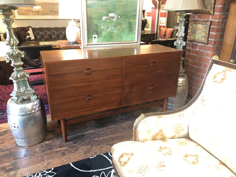 A gorgeously crafted custom chest of drawers purchased in 1960 in Denmark, designed by Henrik and Erik Worts. This superb dresser has 8 drawers with handsome sculptural pulls that are partly recessed and also protruding on the face of the chest.