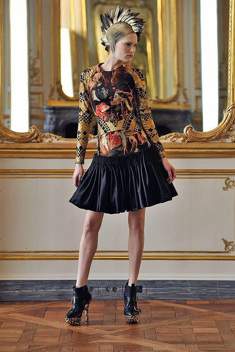 """In his 2010 collection, Alexander McQueen celebrates art and medieval beauty in conjunction with religious iconography.   In look #2 runway, McQueen was very much inspired by the artwork of Hieronymus Bosch in his painting """"Gardens of Earthly"""