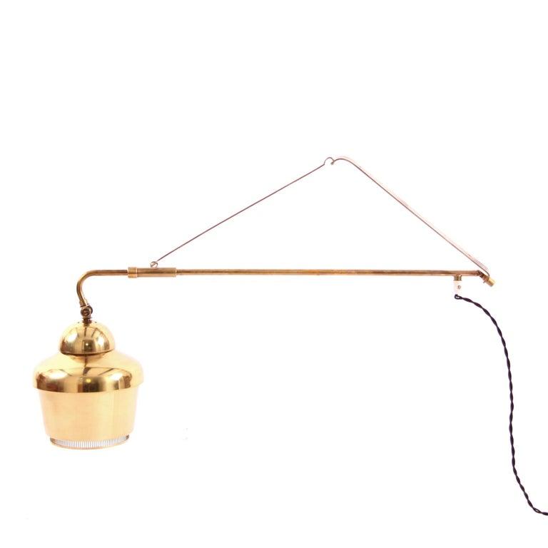 Alvar Aalto & Valaistutyo- Scandinavian Modern  A very rare wall light in brass by Alvar Aalto. The light is a version of the Classic Alvar Aalto Golden bell model A 3305 pendant.  Originally designed in 1937, the lamp was a custom order from