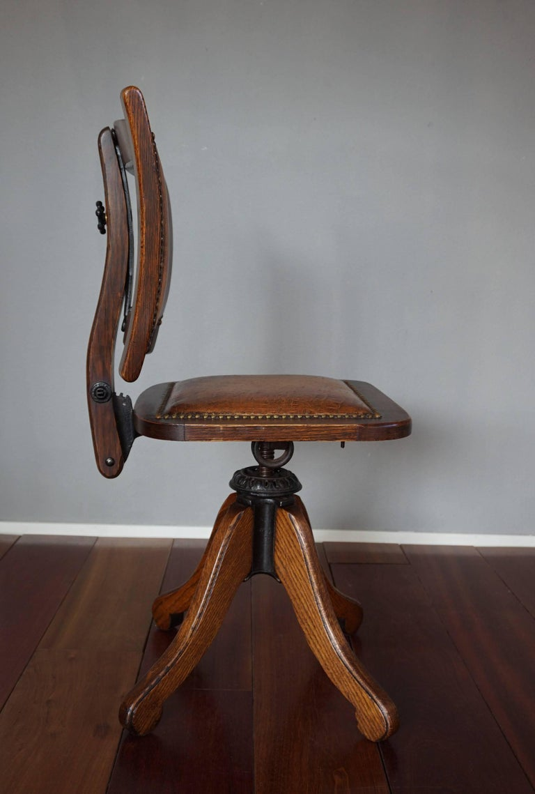 American made, oak and cast iron Arts & Crafts chair with leather upholstery.  The maker of this chair, the Davis Chair Company was founded in 1892 in Marysville, Ohio. We have no idea how this extremely rare and all-American antique chair ended up