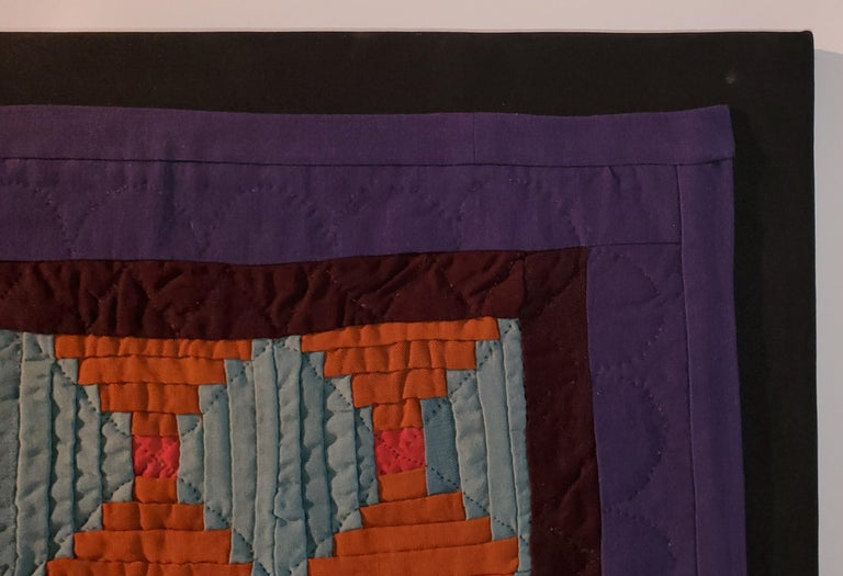 This super rare Amish wool doll quilt is from Lancaster County, Pennsylvania and is in amazing condition and is mounted on frame. The log cabin pattern is very unusual and in orange & light blue. The inner border is burgundy and the border is in