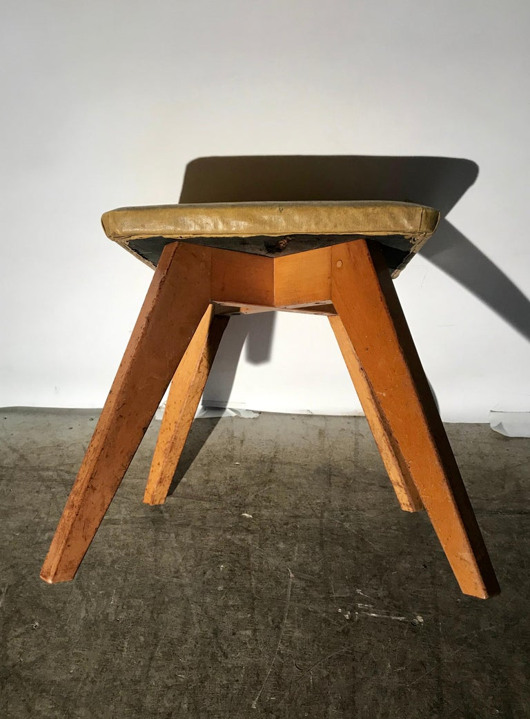 Rare and early Jens Risom stool for Knoll Associates, New York City. Simple, elegant design. Retains original finish as well as original early oil cloth upholstered top. Also original Knoll Associates Label.