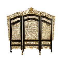 Rare and Exceptional Islamic Gilt and Ebonized Wood Three-Panel Screen