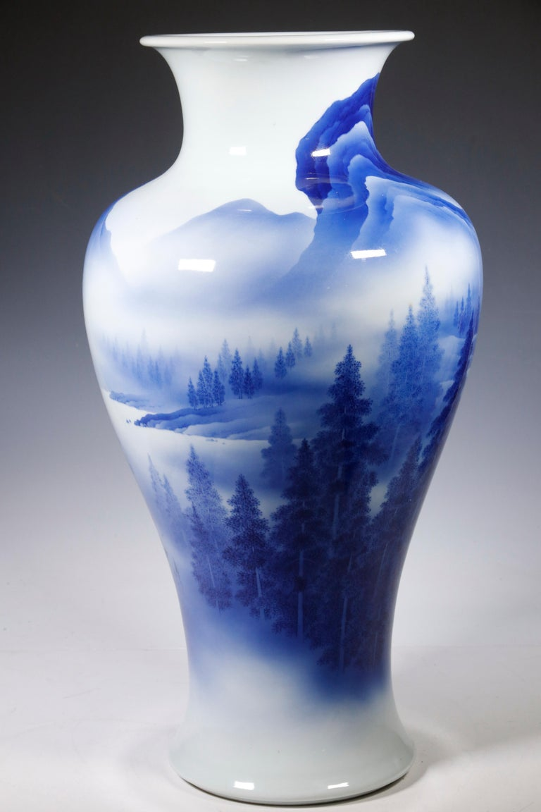 A striking blue and white vase from the studio of Japanese Potter Makuzu Kozan, also known as Miyagawa Kozan (1842–1916), one of the most established and collected ceramist from Meiji Period. Born as Miyagawa Toranosuke, Kozan established his
