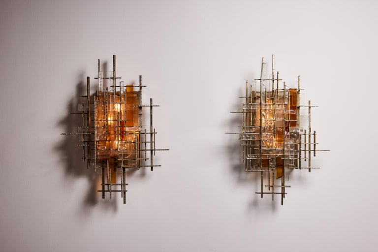 Rare and large pair of wall lights by Albano Poli for Poliarte. Designed and manufactured in Italy, circa 1960's. Steel, glass, painted steel. We recommend four E14 25w maximum candelabra bulbs per fixture. Bulbs provided as a one time courtesy.