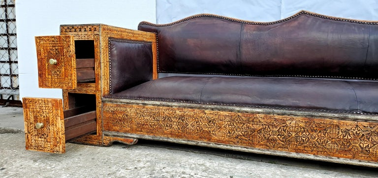 Rare and unique sofa or bench A statement piece! Perfect for a sitting room, library or office!  Inlaid camel bone lounge /sofa / bench  Hand carved henna stained bone. Thick dark hand tanned Moroccan dark leather.  Handmade in Morocco  Unique