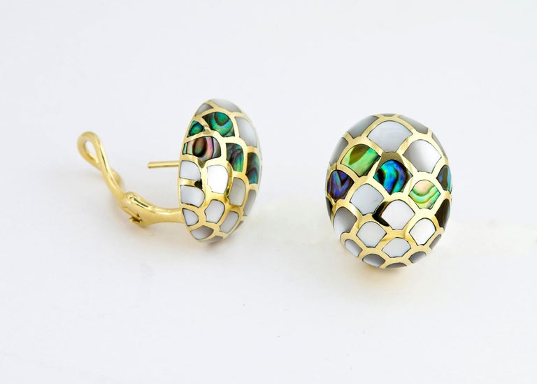 This Angela Cummings design is rarely available. She began he career with Tiffany & Co. before establishing her own company. This intricate pattern is created by carefully combining mother of pearl and abalone. 7/8's of an inch in size.