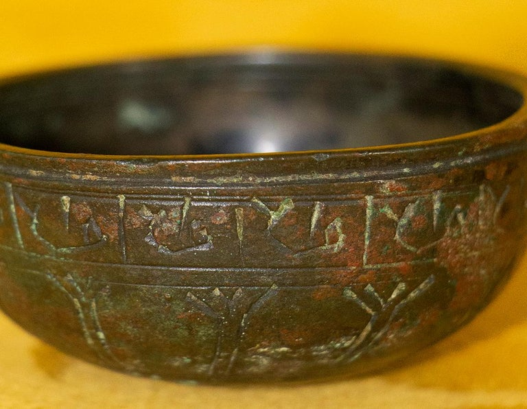 Very rare small Judaic cup from medieval period used for the Kiddush ceremony and also probably for circumcision. This chiseled bronze cup is decorated on its belt, with Hebrew characters. The back of the cup is decorated with the Star of David. The
