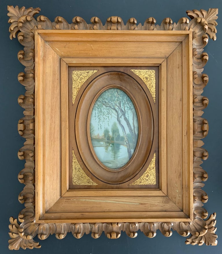 Rare and exceptionally carved picture frame with landscape painting behind convex glass panel.  This unique picture frame is another one of our wonderful recent finds. It truly is a work of art (in more ways than one) and, for us, this rare and