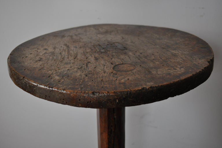 A very rare and unusual haute époque French tripod table, in beautiful untouched condition with superb color and patination. A nice thick beech top with through tenons, chamfered oak column with legs pegged on. The legs are tenoned in on the sides