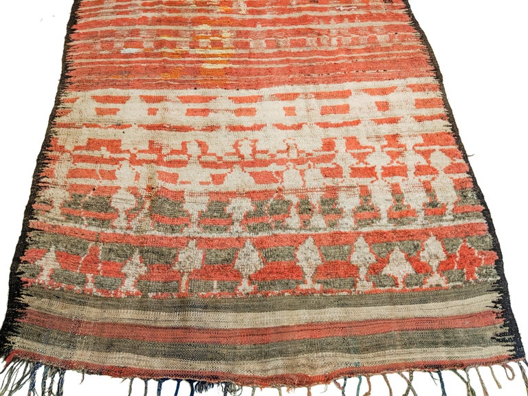 One of the oldest Berber rugs I have personally ever handled, woven in mixed technique with the upper section in flat-weave embellished with some knotted pile and the lower portion completely knotted. The abstract pattern is characteristic of the