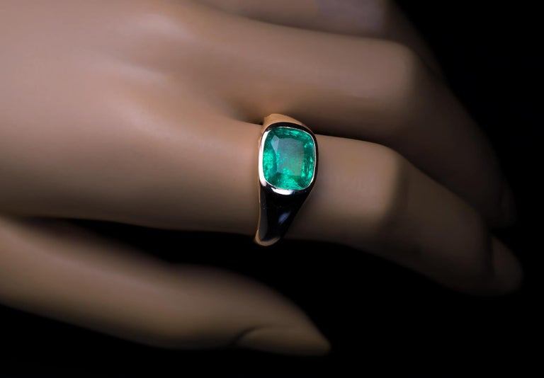 Made in Moscow between 1908 and 1917.  An antique 14K gold ring is horizontally set with a sparkling 3.53 Ct cushion cut emerald of a vivid ocean green color.  Emeralds were discovered in Russia in 1830 near the city of Ekaterinburg in the Ural