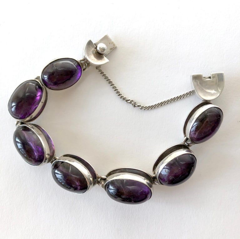Rare to find jewelry suite of amethyst cabochons within sterling silver link necklace, bracelet and earrings all created by Antonio Pineda of Taxco, Mexico circa 1950's.  Necklace measures 17