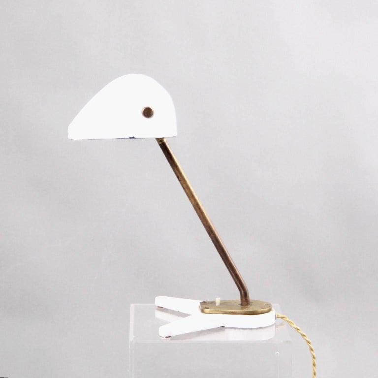 Arne Jacobsen and Hans J. Wegner & Manufacturer Louis Poulsen Scandinavian Modern  A unique desk lamp by the iconic Danish designers Arne Jacobsen and Hans J. Wegner.   This desk lamp was designed for the famous Aarhus City Hall, by architect